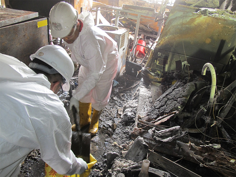 DRS specialists in the process of cleaning up fire damaged-laboratory.