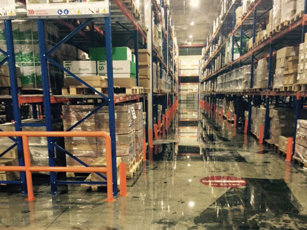 Water damaged goods caused by burst water pipe in warehouse